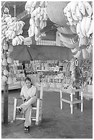 Woman sitting in a fruit stand. Mexico ( black and white)
