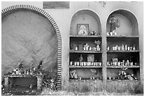 The exterior wall of a roadside chapel. Mexico ( black and white)
