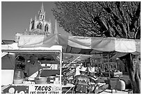 Taco stand on town plaza with cathedral in background. Mexico (black and white)