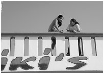 Young women sitting on a roof. Mexico ( black and white)