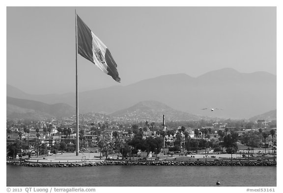 Giean Mexican national flag flying above Malecon, Ensenada. Baja California, Mexico (black and white)