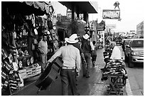 Musicians walking on street, Ensenada. Baja California, Mexico ( black and white)