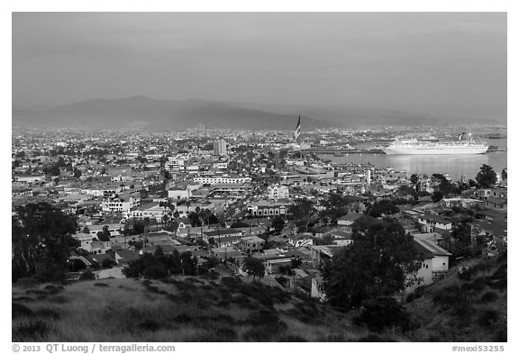 Panoramic view of city from hills at sunset, Ensenada. Baja California, Mexico (black and white)