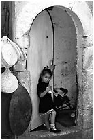 Girl in a doorway. Jerusalem, Israel (black and white)