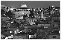 Old town roofs and Dome of the Rock by night. Jerusalem, Israel ( black and white)
