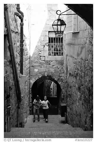 Black and white picture photo children on stairs of an old alley jerusalem israel