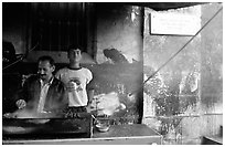 Food vendor broiling meat. Jerusalem, Israel (black and white)