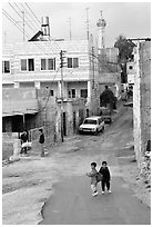 Two schoolchildren in a street of East Jerusalem. Jerusalem, Israel (black and white)