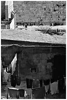 Laundry in a courtyard, with the Western Wall in the background. Jerusalem, Israel (black and white)