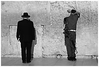 Orthodox Jew and soldier at the Western Wall. Jerusalem, Israel (black and white)