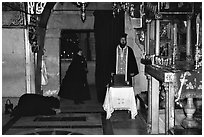 Worshiping inside the Church of the Holy Sepulchre. Jerusalem, Israel ( black and white)