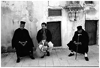 Copt monks and pilgrim in the Ethiopian Monastery. Jerusalem, Israel ( black and white)