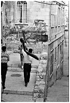 Men carrying crosses. Jerusalem, Israel (black and white)