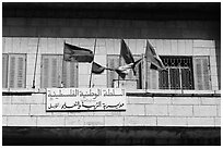 Palestinian flags and inscriptions in arabic in front of a school, East Jerusalem. Jerusalem, Israel ( black and white)