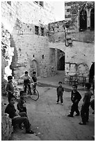 Group of children in old street, Hebron. West Bank, Occupied Territories (Israel) (black and white)