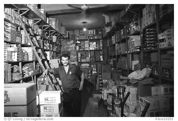 Man in a store, Hebron. West Bank, Occupied Territories (Israel) (black and white)