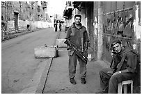 Two young israeli soldiers manning a checkpoint, Hebron. West Bank, Occupied Territories (Israel) ( black and white)