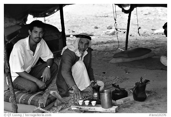 Bedouin men offering tea in a tent, Judean Desert. West Bank, Occupied Territories (Israel)