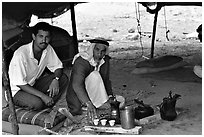 Bedouin men offering tea in a tent, Judean Desert. West Bank, Occupied Territories (Israel) (black and white)