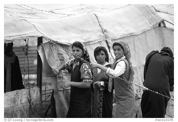 Bedouin women rearranging a tent's cover, Judean Desert. West Bank, Occupied Territories (Israel) (black and white)