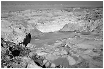 Shallow pond and colored rocks, near Mitzpe Ramon. Negev Desert, Israel ( black and white)