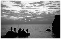 Fishermen standing on a rock, Akko (Acre). Israel ( black and white)