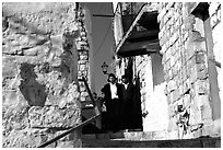 Orthodox jews in a narrow alley, Safed (Tsfat). Israel (black and white)