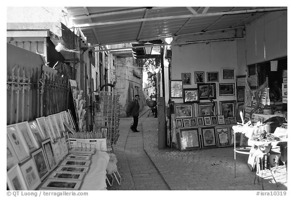 Paintings in Artist's shop, Artist Quarter, Safed (Zefad). Israel (black and white)
