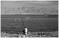 Fishing in the Red Sea, Eilat. Negev Desert, Israel (black and white)