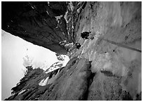Climbers Frank and Alain climb thin ice in the Super-Couloir on Mt Blanc du Tacul, Mont-Blanc Range, Alps, France. (black and white)
