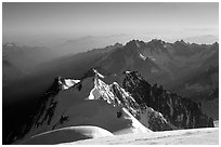 Mount Maudit, Mont-Blanc du Tacul and Aiguille du Midi seen from summit of Mont-Blanc, France. (black and white)