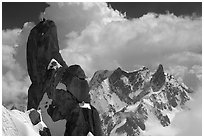Alpinists on a pinacle of Aiguille du Midi after climbing the South Face. Alps, France (black and white)