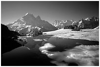 Mountain hut at Lac Blanc and Mont-Blanc range, Alps, France. (black and white)