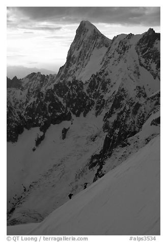 Alpinists climb Aiguille du Midi, France.