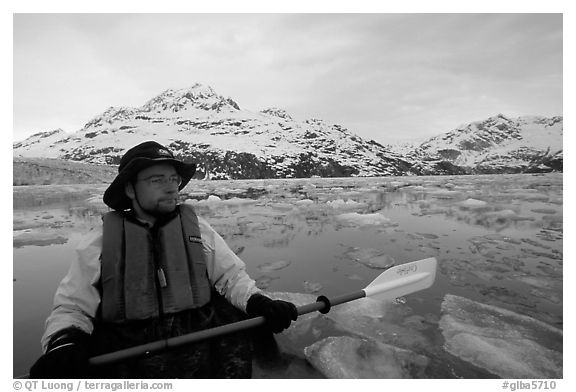Kayaker on ice-chocked waters close to John Hopkins Inlet. Glacier Bay National Park, Alaska