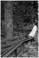 Hiker looking at a tree carved by native Tlingit indians, Bartlett Cove. Glacier Bay National Park, Alaska (black and white)