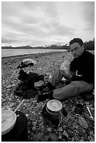 Eating on the shores of Muir Inlet. Glacier Bay National Park, Alaska (black and white)