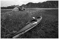 Camp on the flats near McBride Glacier with kayak parked nearby. Glacier Bay National Park, Alaska (black and white)