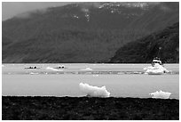 Taxi boat, kayaks, and icebergs near McBride Glacier. Glacier Bay National Park, Alaska (black and white)