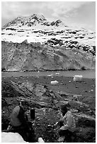 Cooking in front of Lamplugh Glacier. Glacier Bay National Park, Alaska (black and white)
