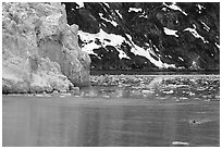 Kayaker paddling away from Lamplugh Glacier. Glacier Bay National Park, Alaska (black and white)