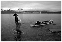 Kayaker towing kayak, East arm. Glacier Bay National Park, Alaska (black and white)