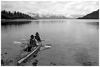 Kayakers land in Hugh Miller Inlet. Glacier Bay National Park, Alaska (black and white)