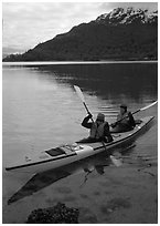 Kayakers in Hugh Miller Inlet. Glacier Bay National Park, Alaska (black and white)