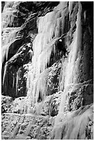 Rappeling from an ice climb in Provo Canyon, Utah. USA (black and white)