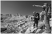 Hikers looking at map and pointing, Dusy Basin. Kings Canyon National Park, California (black and white)
