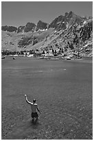Man standing in alpine lake, lower Dusy Basin. Kings Canyon National Park, California (black and white)