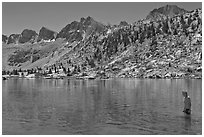 Young man in alpine lake, lower Dusy Basin. Kings Canyon National Park, California (black and white)