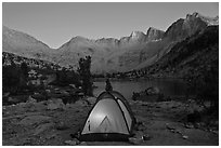 Tent with light and Palisades at dusk, lower Dusy Basin. Kings Canyon National Park, California (black and white)