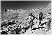 Hikers on trail below Biship Pass, Dusy Basin. Kings Canyon National Park, California (black and white)